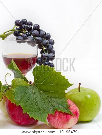 Grapes, Glass Of Wine And Apples