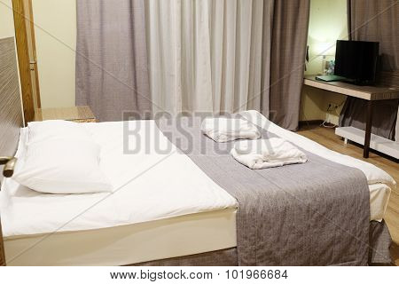 Motel room with queen-size bed