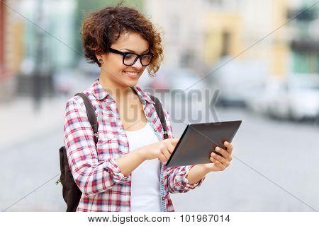 Nice tourist holding laptop