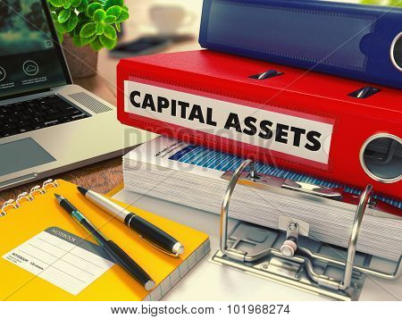 Red Office Folder with Inscription Capital Assets.