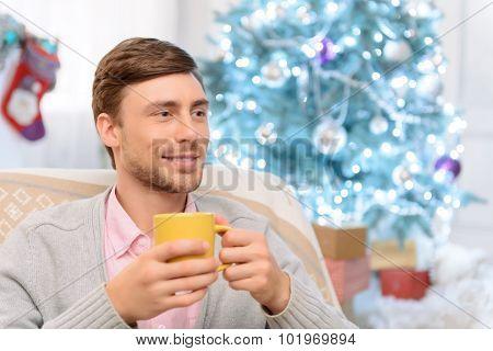 Positive man drinking tea