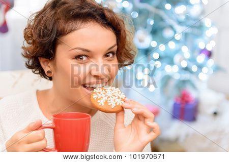 Nice girl eating cookie