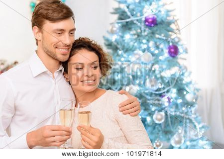Loving couple drinking champagne