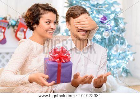 Loving couple holding present
