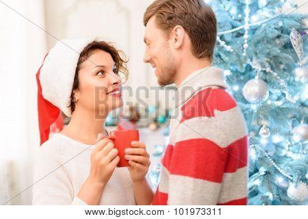 Nice couple standing near Christmas tree