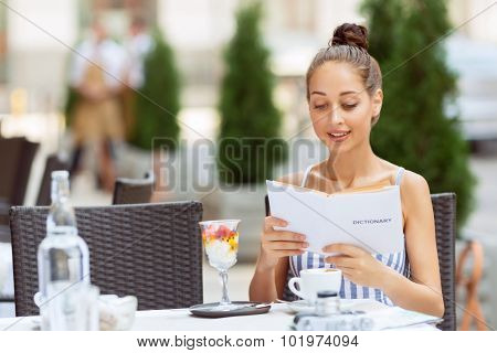 Nice girl sitting in the cafe