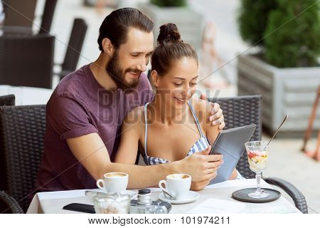 Nice couple sitting in the cafe