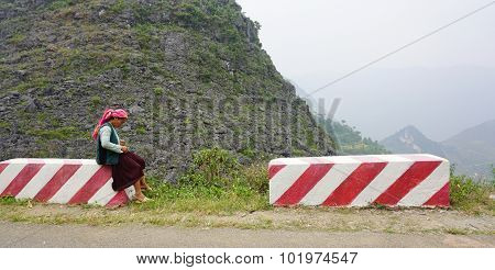 People Sitting On Countryside Road