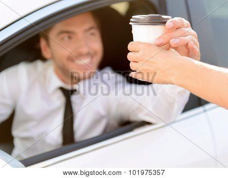 Pleasant businessman driving a car