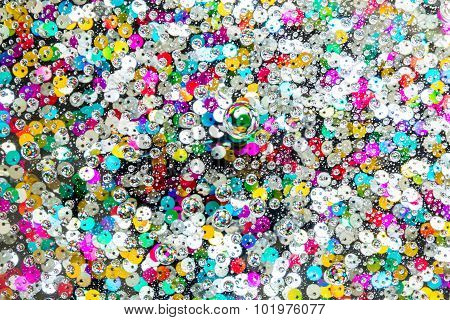Colorful Buttons Under Water Drops Background