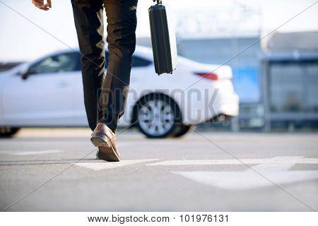 Stylish businessman holding case