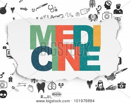 Healthcare concept: Medicine on Torn Paper background