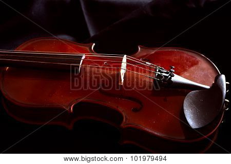 violin lying on the sheet of music, music concept