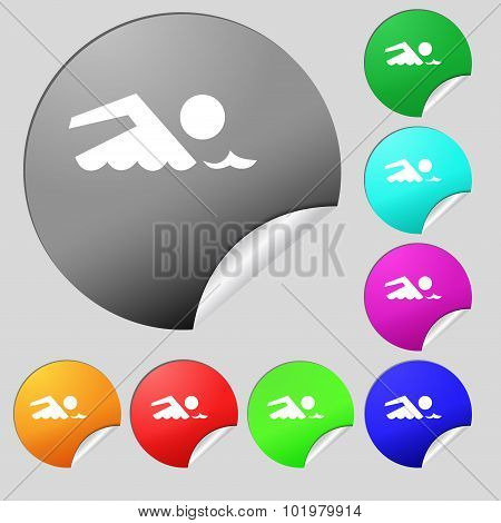 Swimming Sign Icon. Pool Swim Symbol. Sea Wave. Set Of Eight Multi Colored Round Buttons, Stickers.
