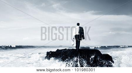 Business Man Standing Rock Ocean Life Buoy Concept