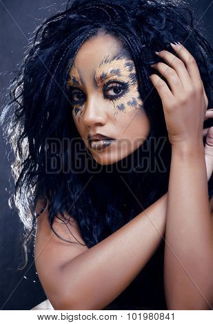 beauty afro girl with cat make up, creative leopard print closeup