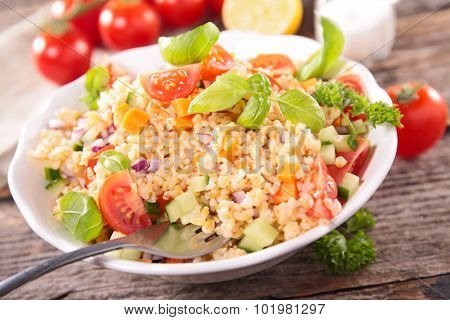 salad with quinoa,tomato,cucumber and basil