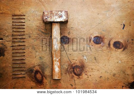 Vintage wood table with hammer and nails