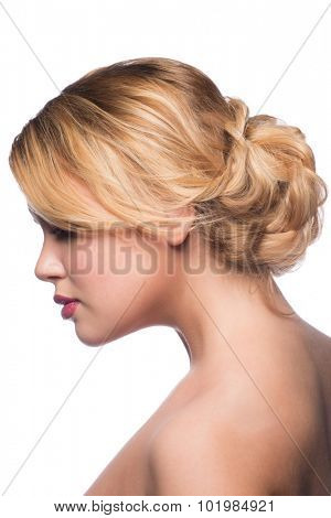 Woman with modern stylish hairdo, side view. Isolated on white background.