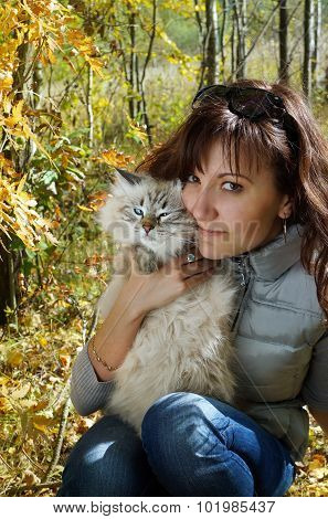Siberian Nevsky Masqarade Cat And Young Woman