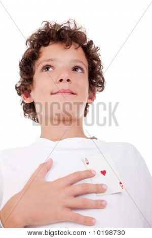 Cute Boy Showing An Ace Of Hearts, In Place Of The Heart, Isolated On White, Studio Shot