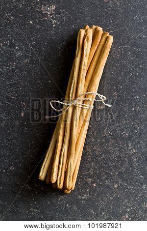 breadsticks grissini on black table