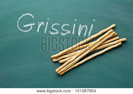 breadsticks grissini on chalkboard