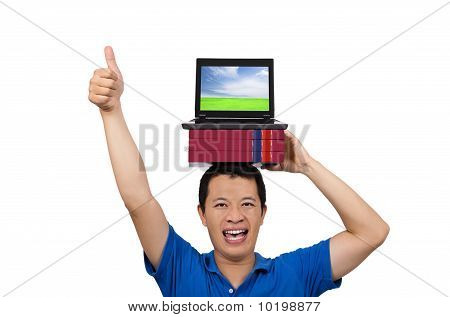 young man gives his thumbs up with book and laptop