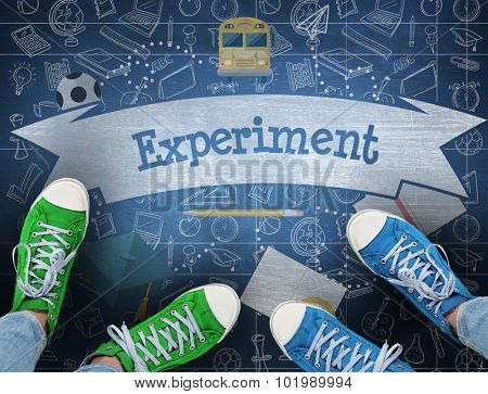 The word experiment and casual shoes against blue chalkboard