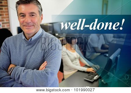 The word well-done! against teacher smiling at top of computer class
