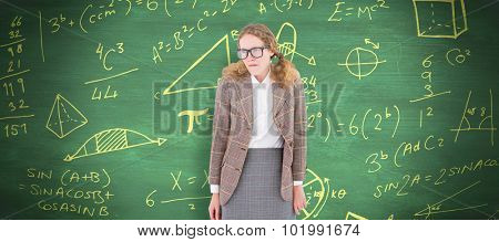 Geeky hipster woman looking nervous against green chalkboard