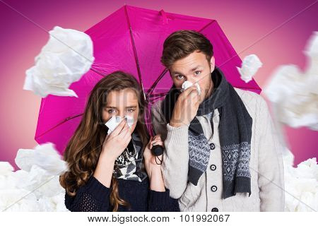 Couple blowing nose while holding umbrella against pink vignette