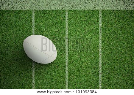 Close-up of rugby ball against pitch with lines