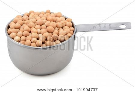 Dried Chick Peas In A Measuring Cup