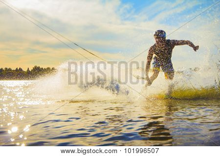 wakeboarder trains on the lake