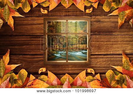 Window against autumn scene