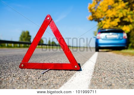 sign emergency stop on the blue car background