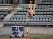 foto of pole-vault  - female pole vaulter about to clear the bar - JPG