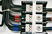 stock photo of busbar  - close up shot of an electrical panel wiring with color coded cables - JPG