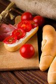 Постер, плакат: Fresh Red Cherry Tomato Between Rolls And Baguette