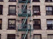 Постер, плакат: Old brick apartment building