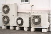 stock photo of air conditioner  - air conditioner installation in the backside of a building - JPG