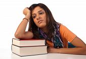 foto of droopy  - Middle eastern student in an uninterested attitude towards her books - JPG
