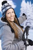 Attractive Female Dressed For Skiing Smiling