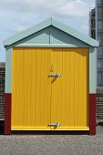picture of wooden door  - Beach hut with yellow doors on seafront promenade at Hove - JPG