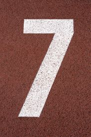 stock photo of number 7  - Number Seven signpost in an athletic running track - JPG