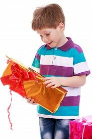 picture of tissue box  - Cute little boy in a striped shirt holding a box of beautifully packaged in tissue paper - JPG