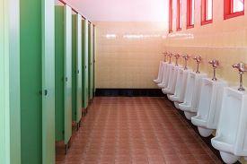 stock photo of urinate  - row white urinals in men - JPG