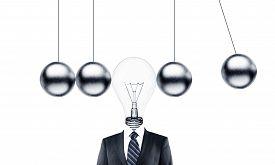picture of pendulum  - businessman head lamp and metal pendulum - JPG