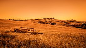 image of farmhouse  - Fields of Tuscany with farmhouse on a hill - JPG